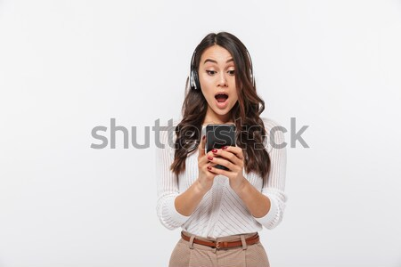 Portrait of shocked attractive woman in black dress Stock photo © deandrobot