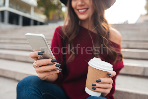 Cropped image of smiling brunette woman in hat and sweater Stock photo © deandrobot