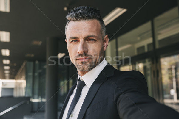 Portrait of a successful young businessman Stock photo © deandrobot