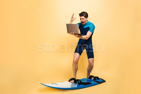 Full length portrait of an angry young man Stock photo © deandrobot