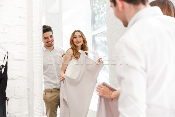 Happy young couple choosing dress Stock photo © deandrobot