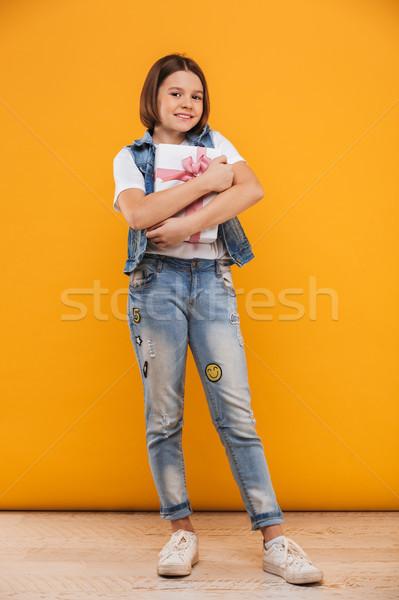 Full length portrait of a satisfied little schoolgirl Stock photo © deandrobot
