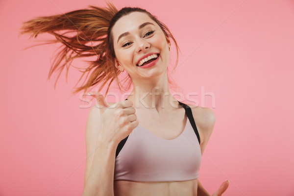 Stock photo: Cheerful young fitness sports woman running