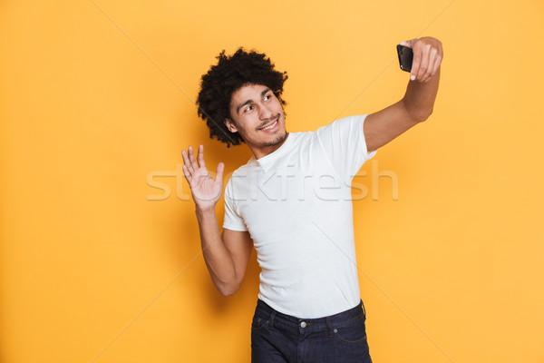 Portret vrolijk jonge afrikaanse vent Stockfoto © deandrobot
