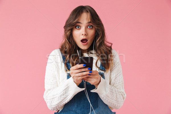 Portrait of a shocked young girl Stock photo © deandrobot