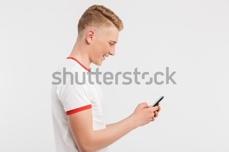 Profile image of satisfied teenage man wearing casual clothing t Stock photo © deandrobot