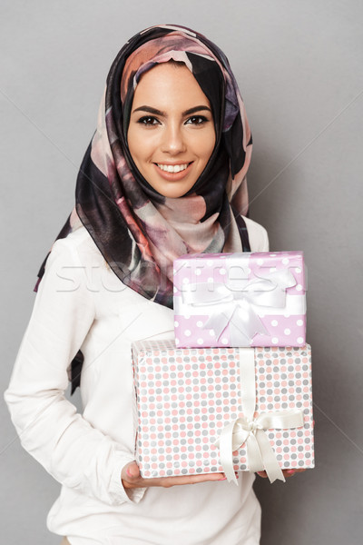 Portrait of a smiling young arabian woman Stock photo © deandrobot