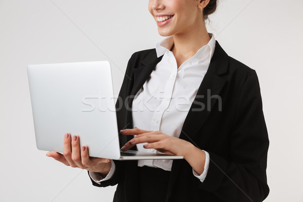 Cropped photo of smiling young business woman Stock photo © deandrobot