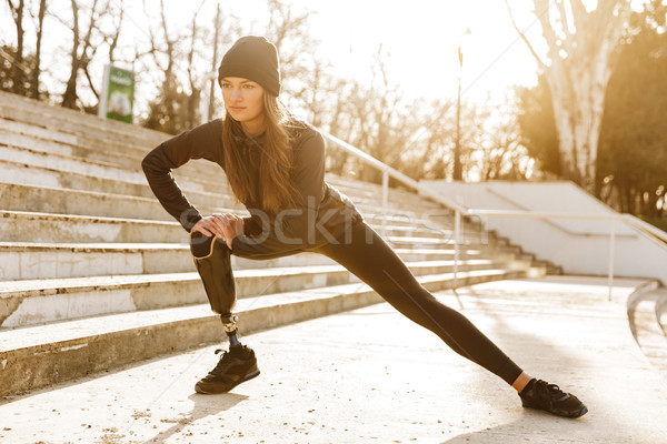 Image of disabled athletic girl in sportswear, doing sit ups and Stock photo © deandrobot