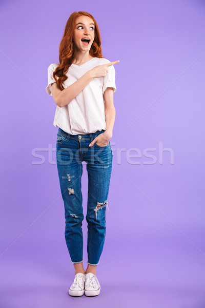 Full length portrait of a smiling young girl standing Stock photo © deandrobot