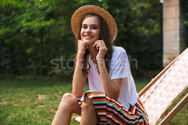 魅力的な 若い女の子 ハンモック 市 公園 ストックフォト © deandrobot