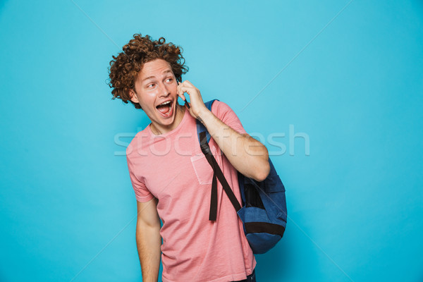 Foto glücklich College guy lockiges Haar tragen Stock foto © deandrobot