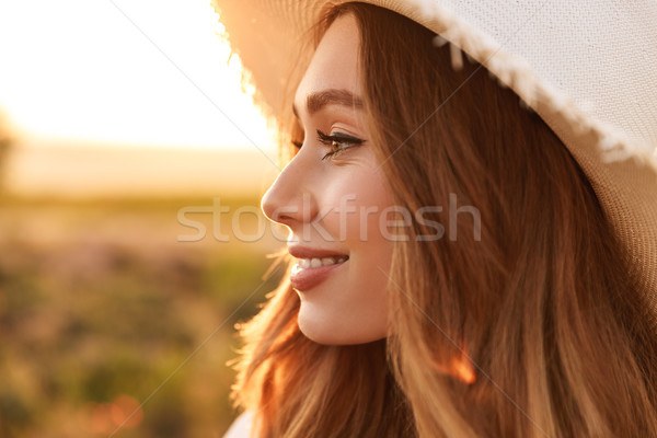 Close up of a cheerful young girl in straw hat Stock photo © deandrobot
