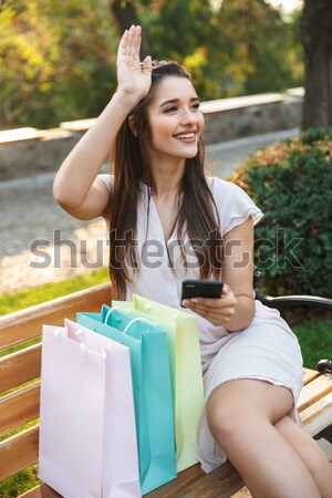 Back view image of two smiling young women Stock photo © deandrobot