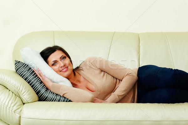 Gelukkig vrouw sofa home meisje Stockfoto © deandrobot