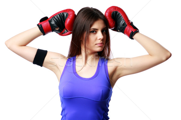 Young fitness woman wearing boxing gloves standing isolated on white background Stock photo © deandrobot
