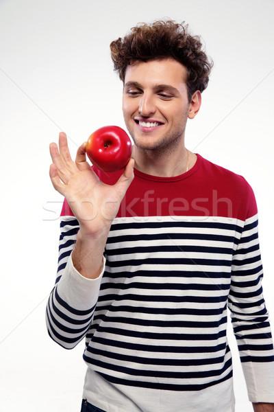 Portret szczęśliwy człowiek czerwone jabłko szary Zdjęcia stock © deandrobot