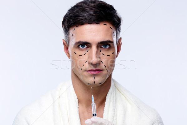 Séduisant homme chirurgie esthétique seringue visage hommes Photo stock © deandrobot