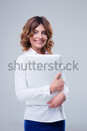 女實業家 常設 筆記本電腦 灰色 商業照片 © deandrobot