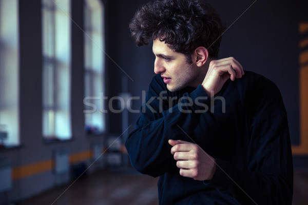 Stock photo: Young handsome male dancer posing at gym