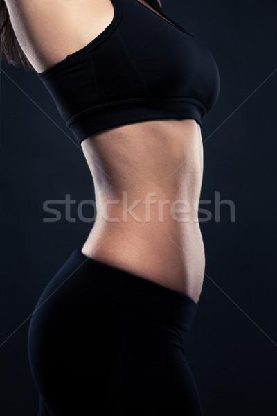 Closeup portrait of a women`s perfect body Stock photo © deandrobot