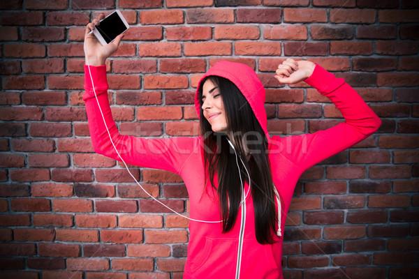 Stock fotó: Boldog · nő · hallgat · zene · tánc · fejhallgató