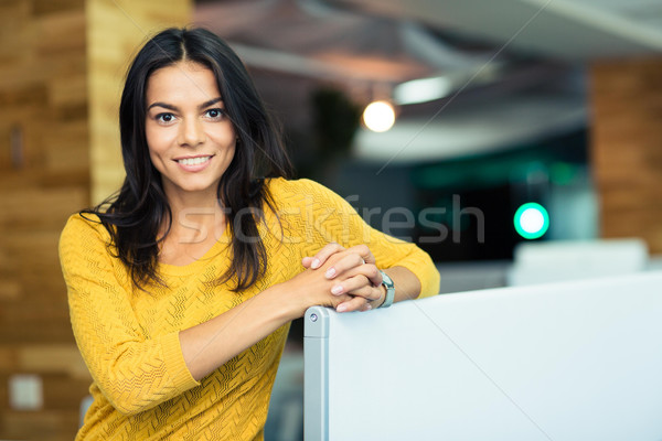 Portrait of a happy beautiful businesswoman  Stock photo © deandrobot
