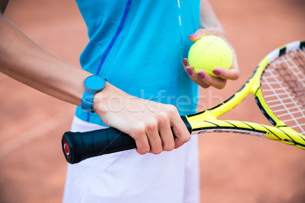 Female tennis player holding racket and ball Stock photo © deandrobot