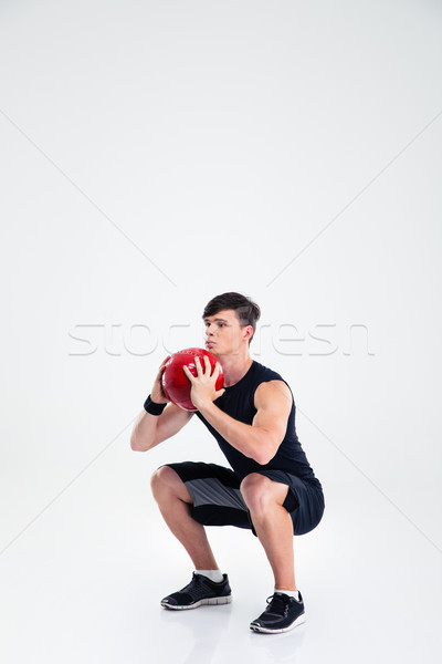 Sports man workout with fitness ball  Stock photo © deandrobot