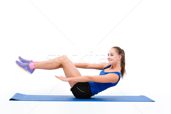 Fitness woman doing abs exercises on yoga mat Stock photo © deandrobot