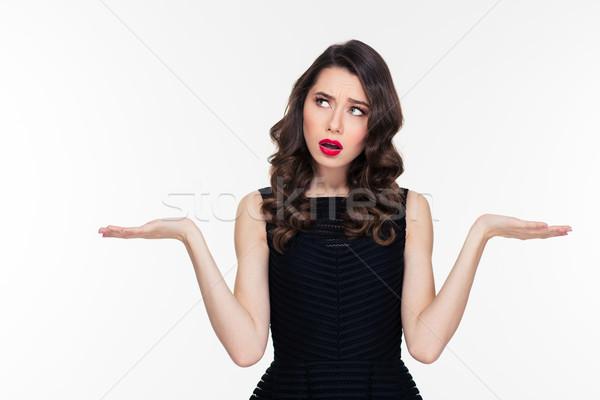 Confuso mulher jovem cópia espaço Foto stock © deandrobot