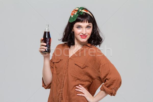 Vonzó nő pózol üveg édes szénsavas Stock fotó © deandrobot
