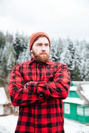 Bebaarde man rugzak winter berg bos Stockfoto © deandrobot