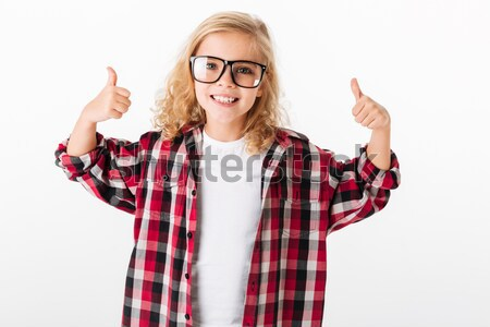 Happy teenage girl in glasses holding copyspace on both palms  Stock photo © deandrobot
