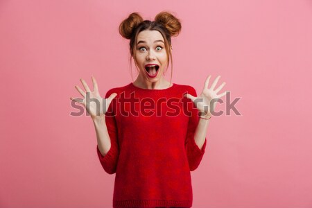 Surprised shocked woman with mouth opened holdin copyspace on palms  Stock photo © deandrobot