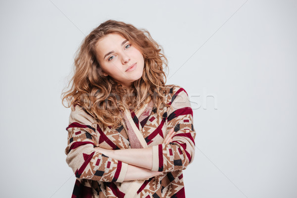 Woman standing with arms folded and looking at camera  Stock photo © deandrobot