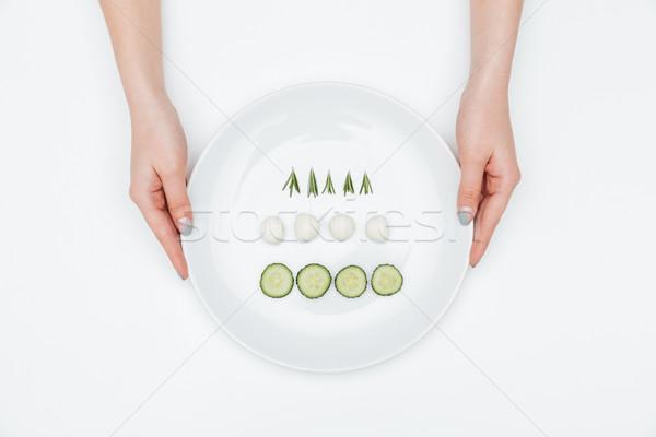 Twee handen plaat komkommer mozzarella Stockfoto © deandrobot