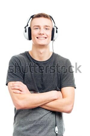 Człowiek stałego broni fałdowy słuchania muzyki Zdjęcia stock © deandrobot