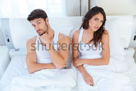 Husband while his internet addict wife is using mobile phone Stock photo © deandrobot
