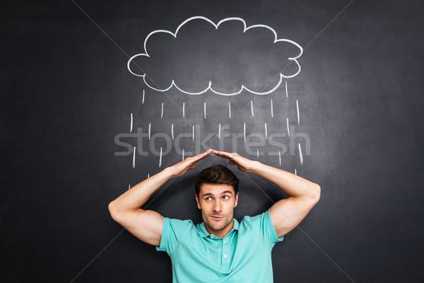 不幸 若い男 雨 黒板 屋根 ストックフォト © deandrobot