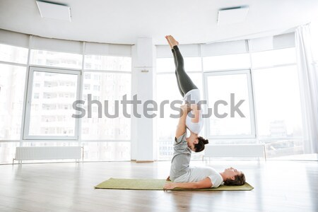 Vreedzaam vrouw oefenen yoga partner studio Stockfoto © deandrobot
