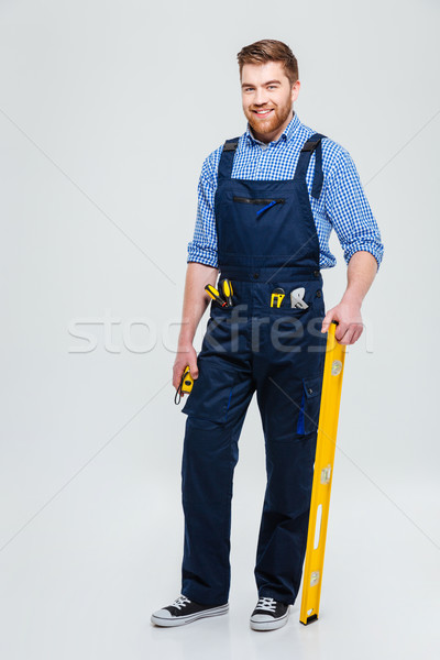 Full length portrait of a handsome male builder Stock photo © deandrobot