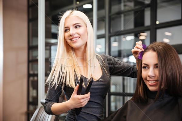 стилист железной женщину парикмахерская молодые волос Сток-фото © deandrobot