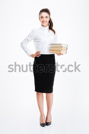 Full length portrait of businesswoman standing with hand on hip Stock photo © deandrobot