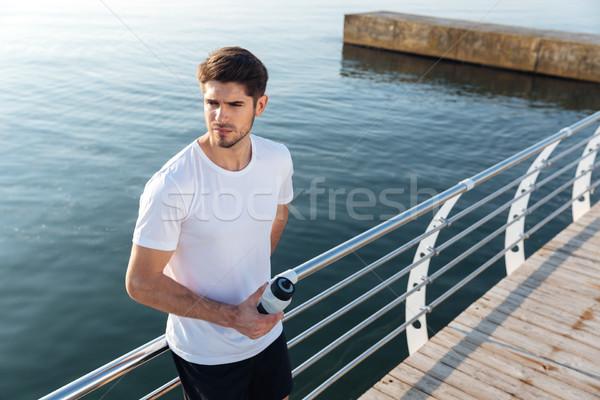スポーツマン 立って 海 飲料水 ハンサム 小さな ストックフォト © deandrobot