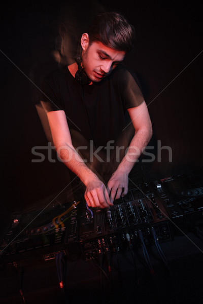 Dj playing music and mixing tracks Stock photo © deandrobot