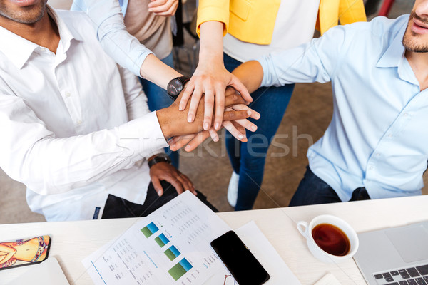Group of business people joining hands Stock photo © deandrobot