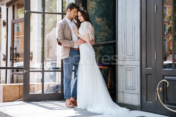 Modern tender young couple of groom and bride Stock photo © deandrobot