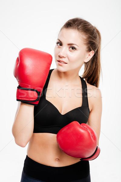 спортивных женщину боксерские перчатки глядя камеры изолированный Сток-фото © deandrobot