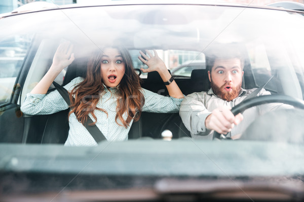 Frightened couple in car Stock photo © deandrobot